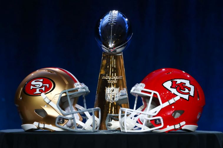 Super Bowl helmets with the Lombardi trophy