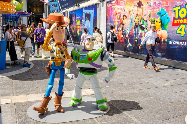 Replicas of Sheriff Woody and Buzz Lightyear at a carnival