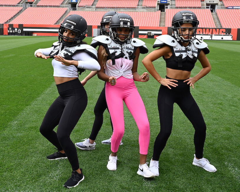 Deandra, Kiarra, and Sydney on the football field during 'The Bachelor' Season 24, Episode 4.