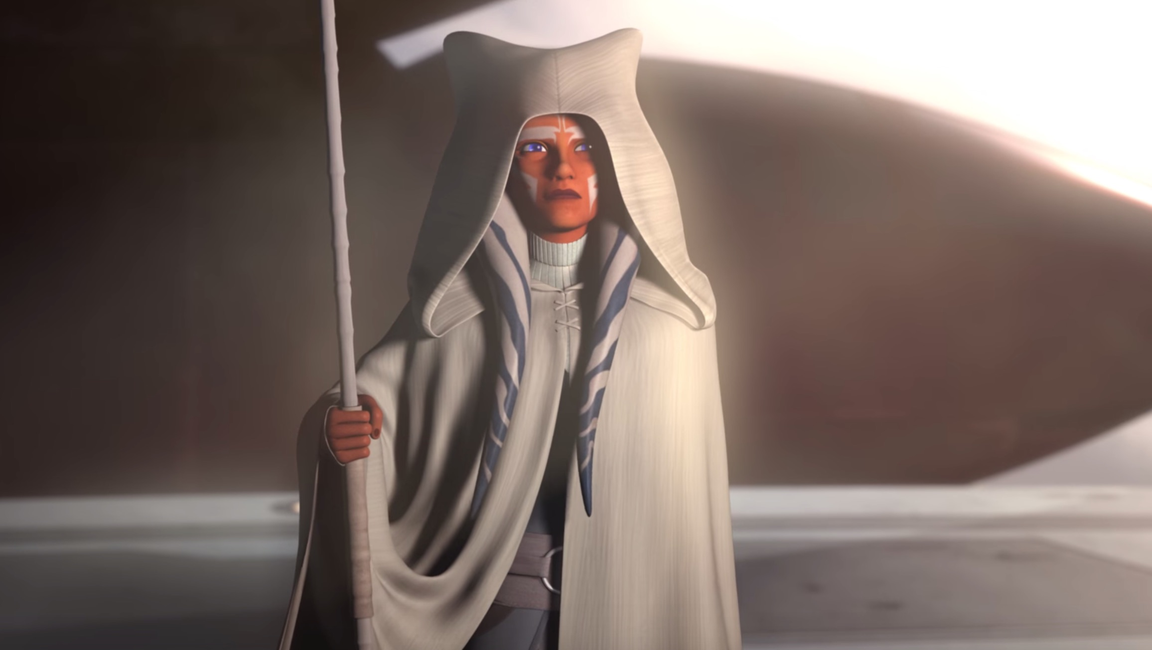 Ahsoka Tano stands with her white robe and staff in the Epilogue of 'Star Wars Rebels.'