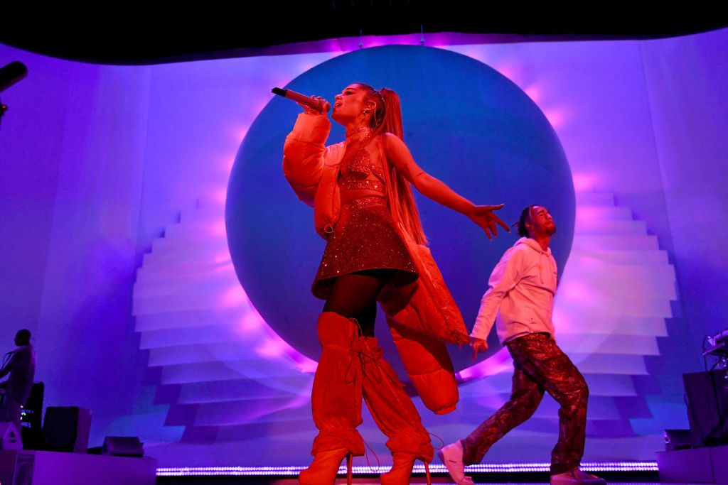 Ariana Grande performs on stage with Mikey Foster of Social House during her 'Sweetener World Tour' on August 19, 2019, in London, England.