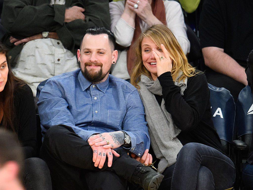 Benji Madden and Cameron Diaz at basketball game