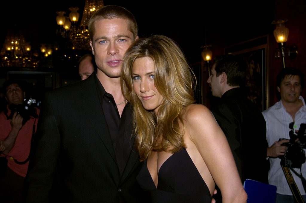 """Brad Pitt and Jennifer Aniston attend the U.S. premiere of the movie """"Troy"""" at the Ziegfeld Theater."""