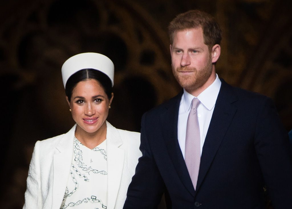 Prince Harry and Meghan Markle attend a service.