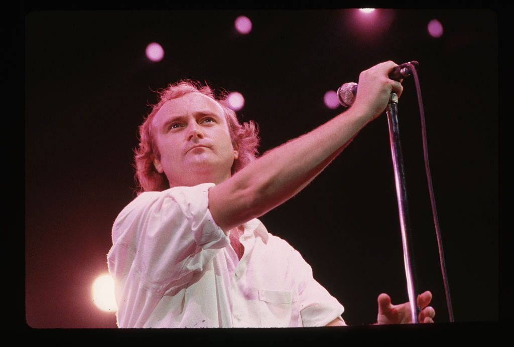 Phil Collins with a microphone