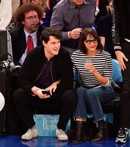 Rashida Jones and Ezra Koenig at a basketball game