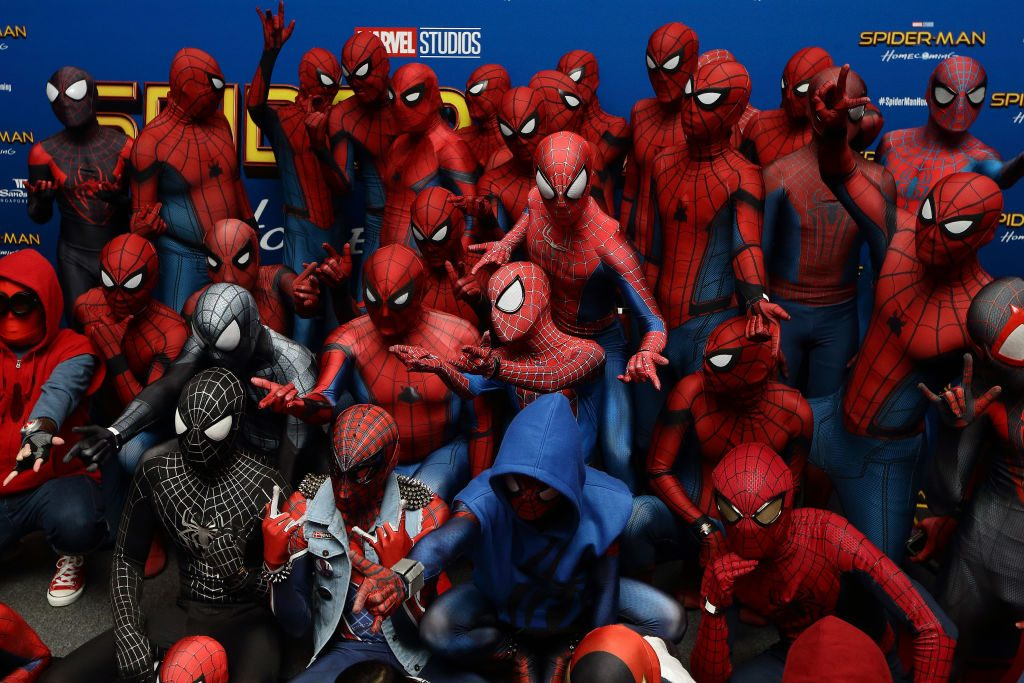 """ans dressed in Spider-Man costumes attend the """"Spider-Man: Homecoming"""" red carpet fan event at ArtScience Museum, Marina Bay Sands"""