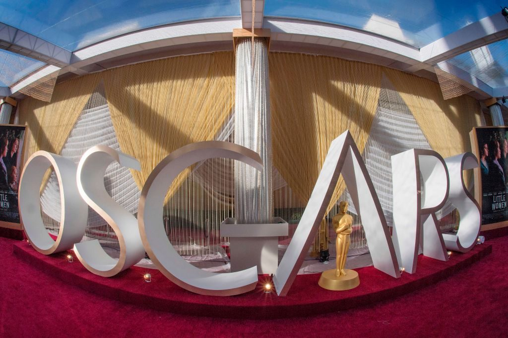 An Oscars sign and statue on display