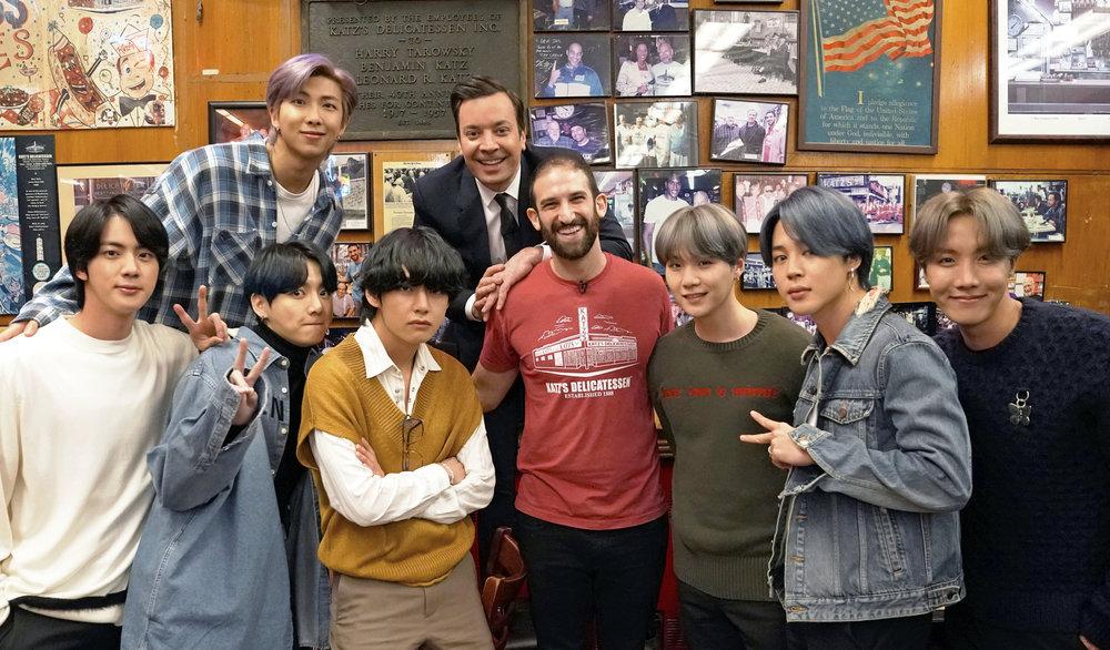 RM, host Jimmy Fallon, (bottom row l-r) Jin, Jungkook, V, a Katz Deli employee, SUGA, Jimin, and J-Hope of BTS on February 24, 2020