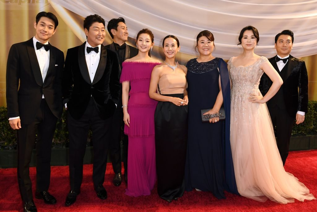 """The cast of """"Parasite"""" on the red carpet at the Oscars in February 2020"""