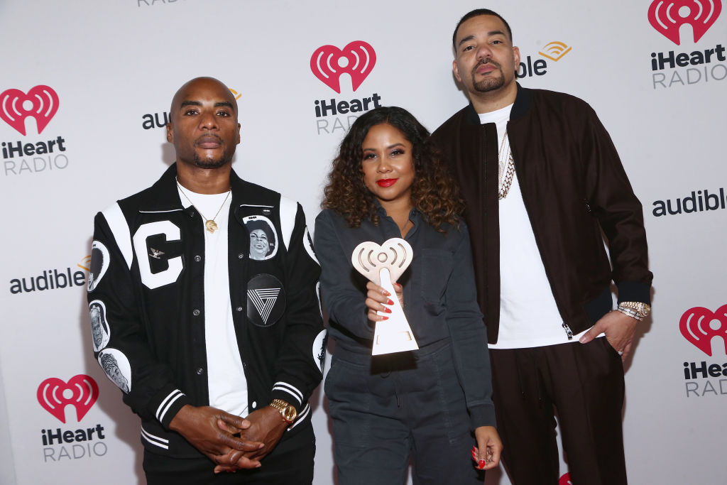 Charlamagne Tha God, Angela Yee, and DJ Envy on the red carpet in January 2020