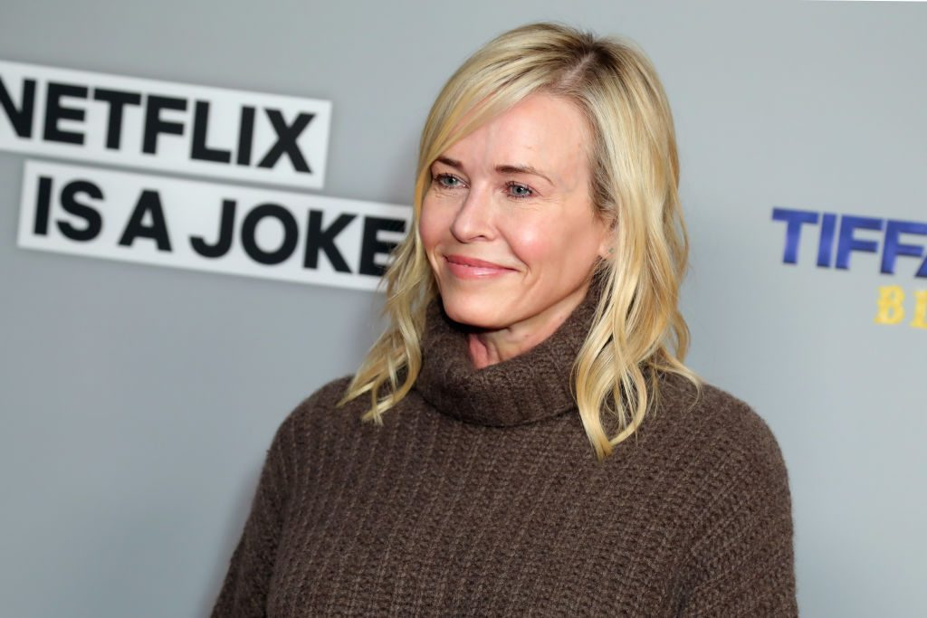 Chelsea Handler in a turtleneck sweater, smiling off camera