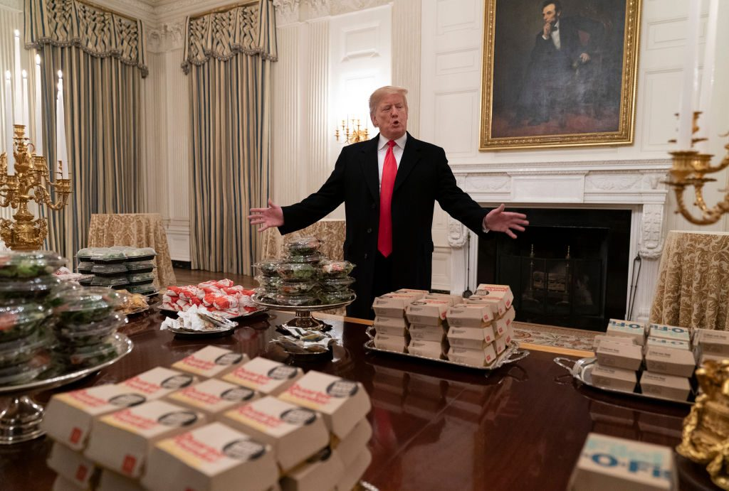 U.S President Donald Trump presents fast food to be served to the Clemson Tigers football team