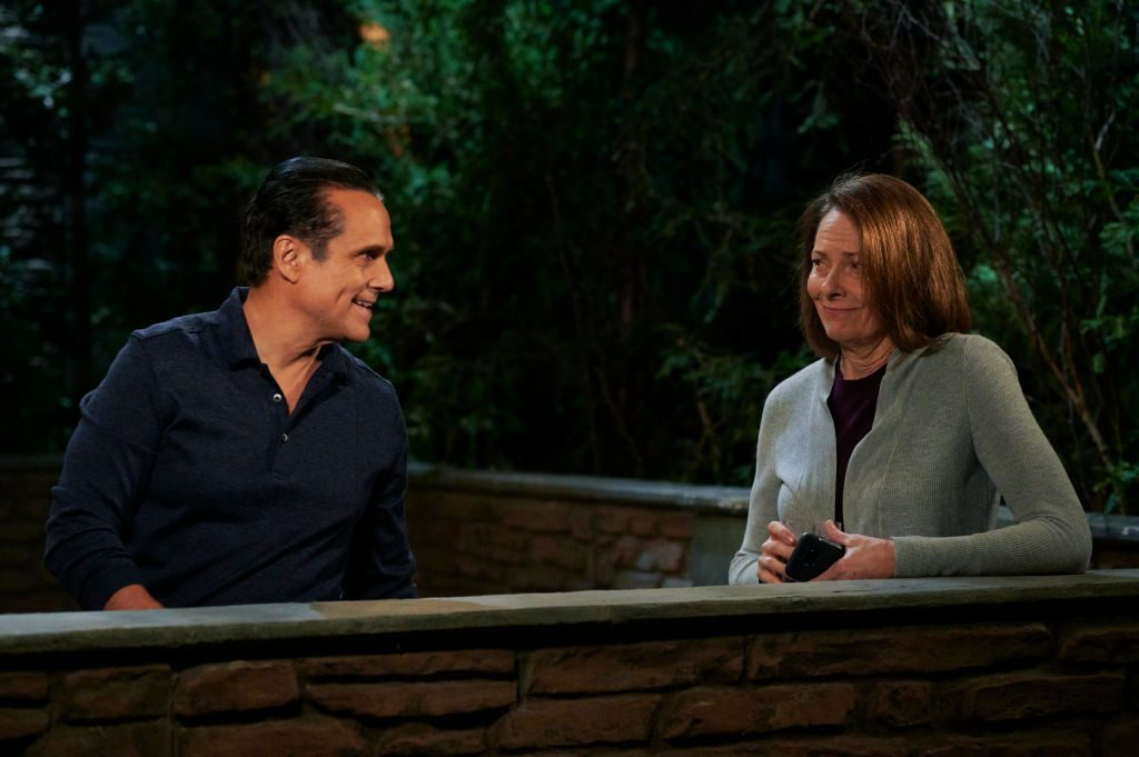 Maurice Benard and Bonnie Burroughs on set of 'General Hospital' having a conversation in front of greenery