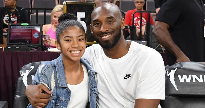 Gianna and Kobe Bryant at a basketball game