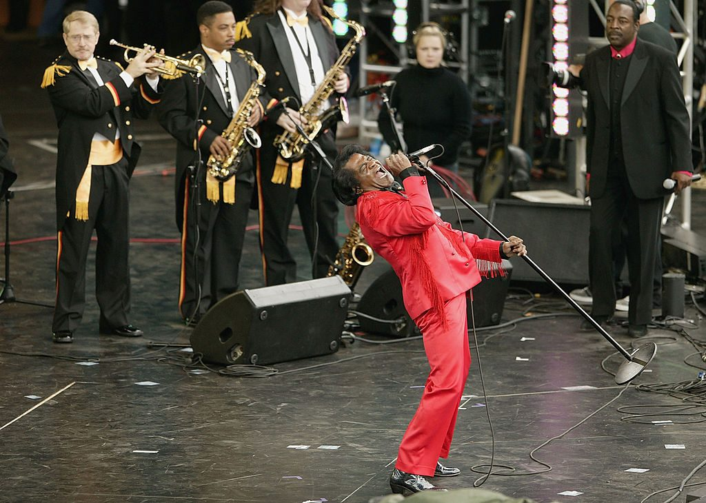 James Brown performs on stage at the Olympic Torch Concert held in The Mall on June 26, 2004 in London