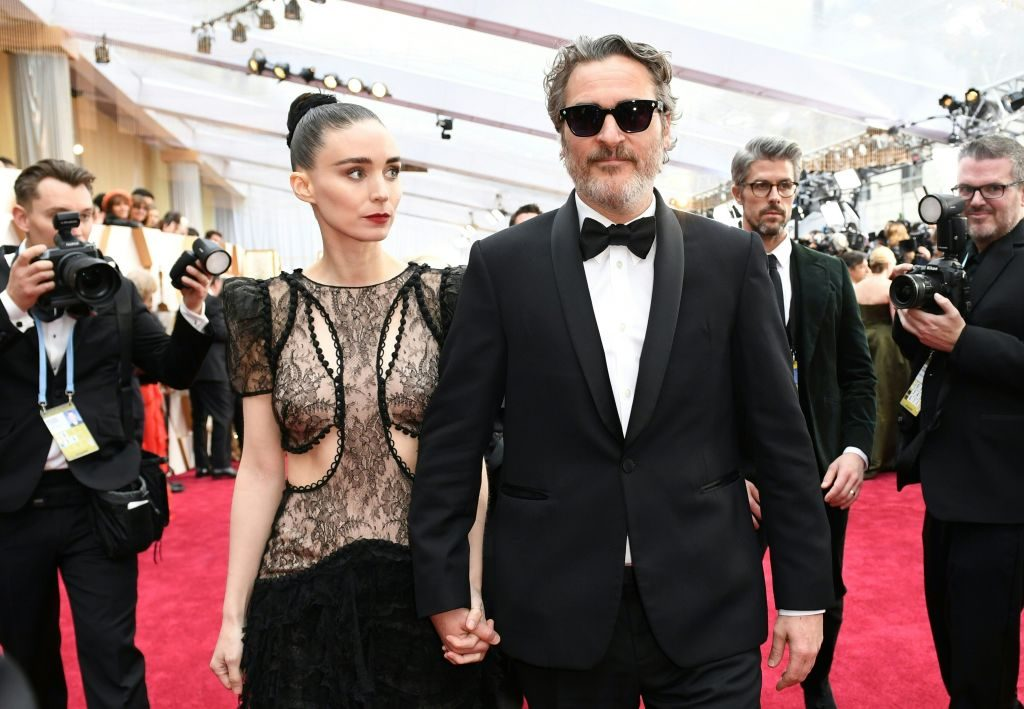 Rooney Mara (left) holding hands with Joaquin Phoenix (right)