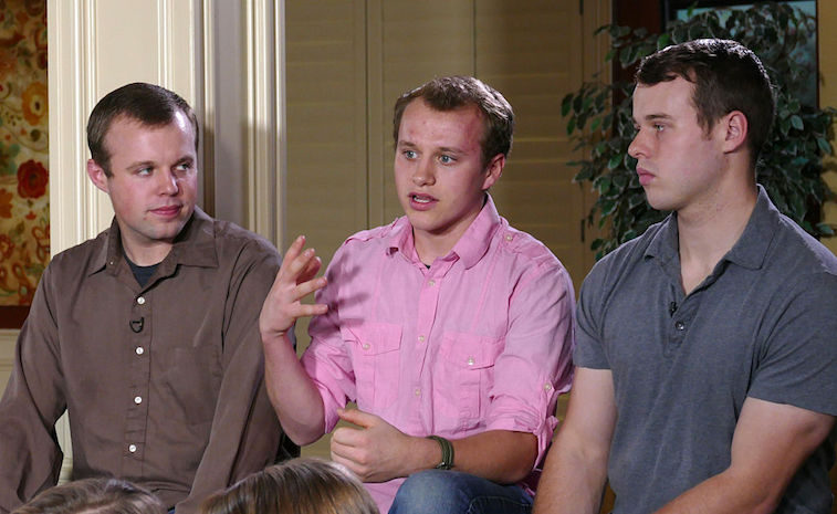 Josiah Duggar, center, with two of his brothers