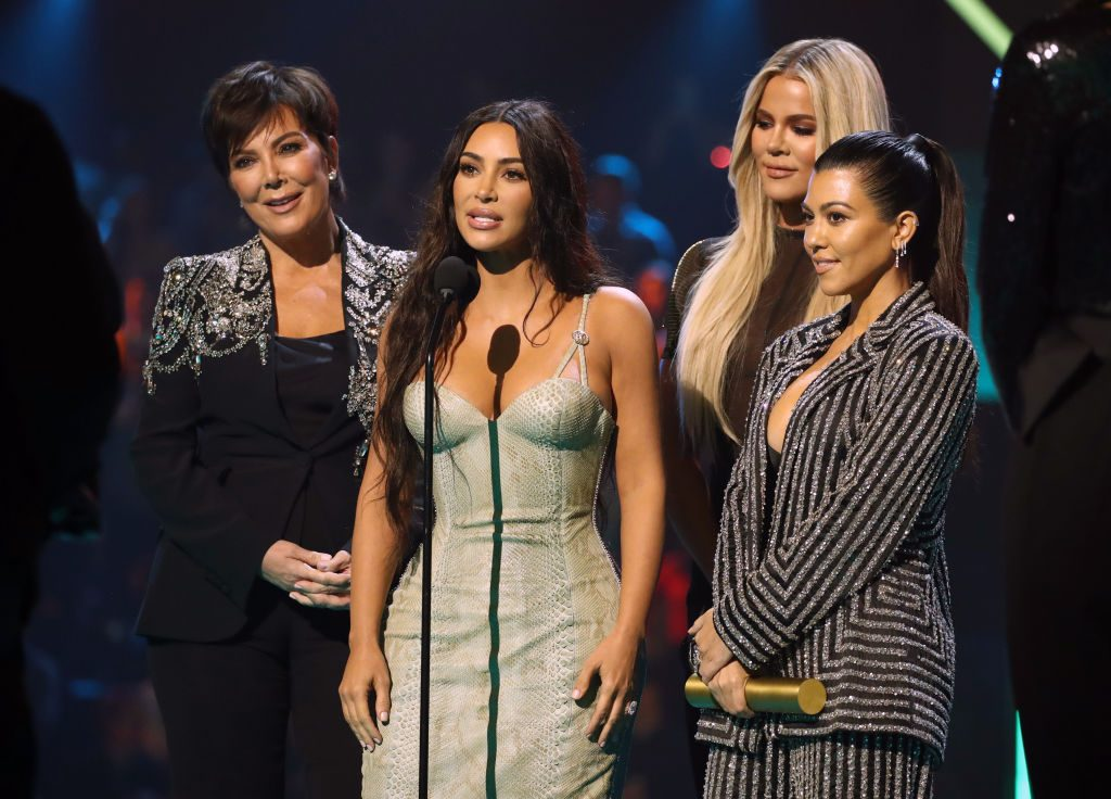 Kris Jenner, Kim Kardashian, Khloé Kardashian, and Kourtney Kardashian accept The Reality Show of 2019 for 'Keeping Up with the Kardashians' on stage during the 2019 E! People's Choice Awards