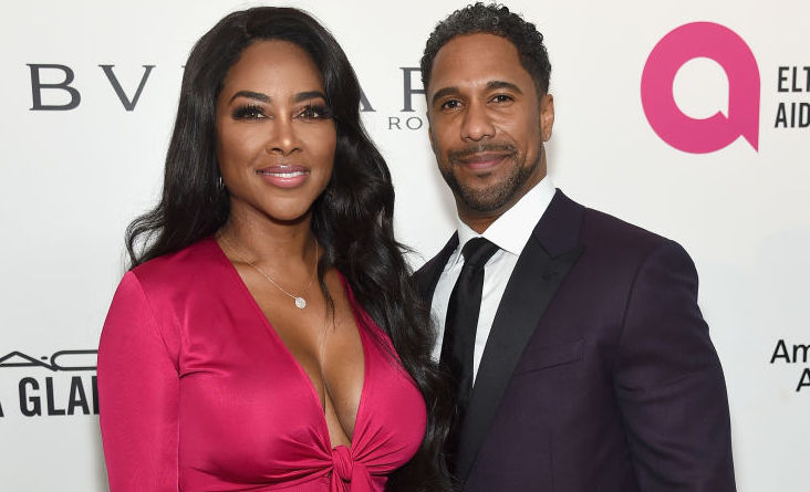 Kenya Moore and Marc Daly at an event
