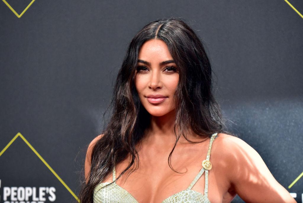 Kim Kardashian smiling off camera