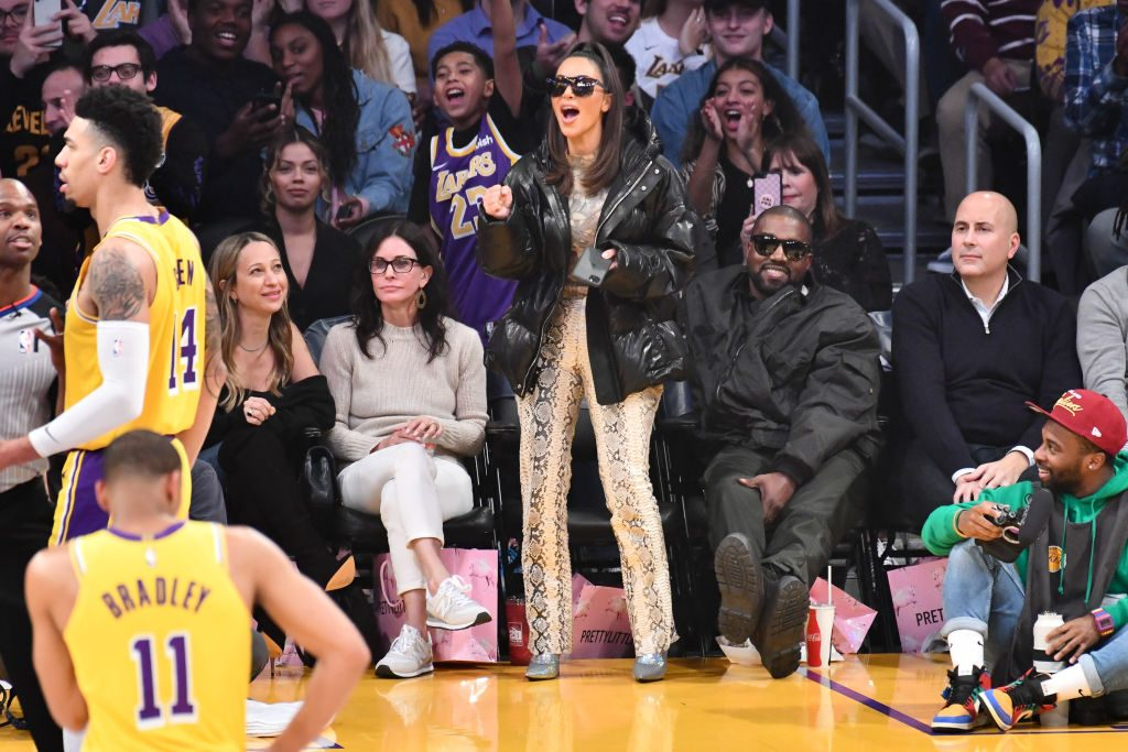 Kim Kardashian and Kanye West attend a basketball game between the Los Angeles Lakers and the Cleveland Cavaliers