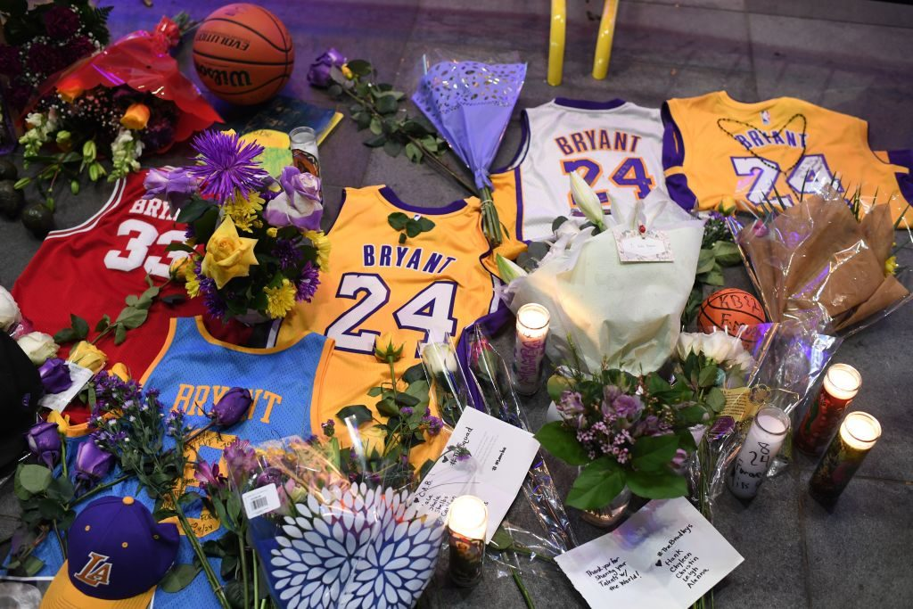 Jerseys, flowers and candles are placed at a makeshift memorial as fans mourn the death of NBA legend Kobe Bryant,