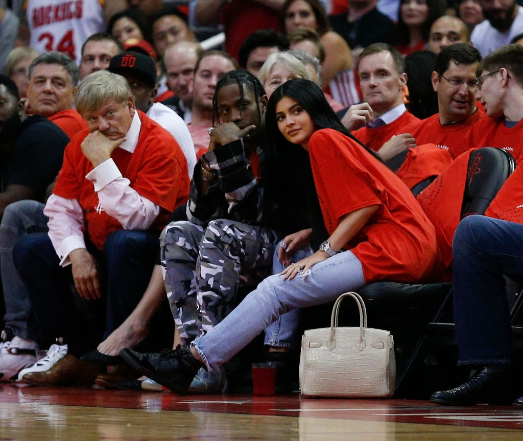 Travis Scott and Kylie Jenner at a basketball game