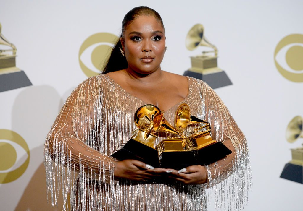 Lizzo poses in the press room during the 62nd Annual GRAMMY Awards.