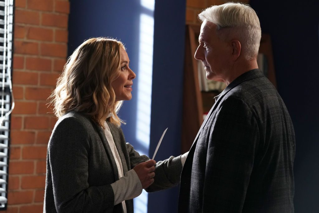 Maria Bello and Mark Harmon on the set of NCIS |  by Patrick McElhenney/CBS via Getty Images