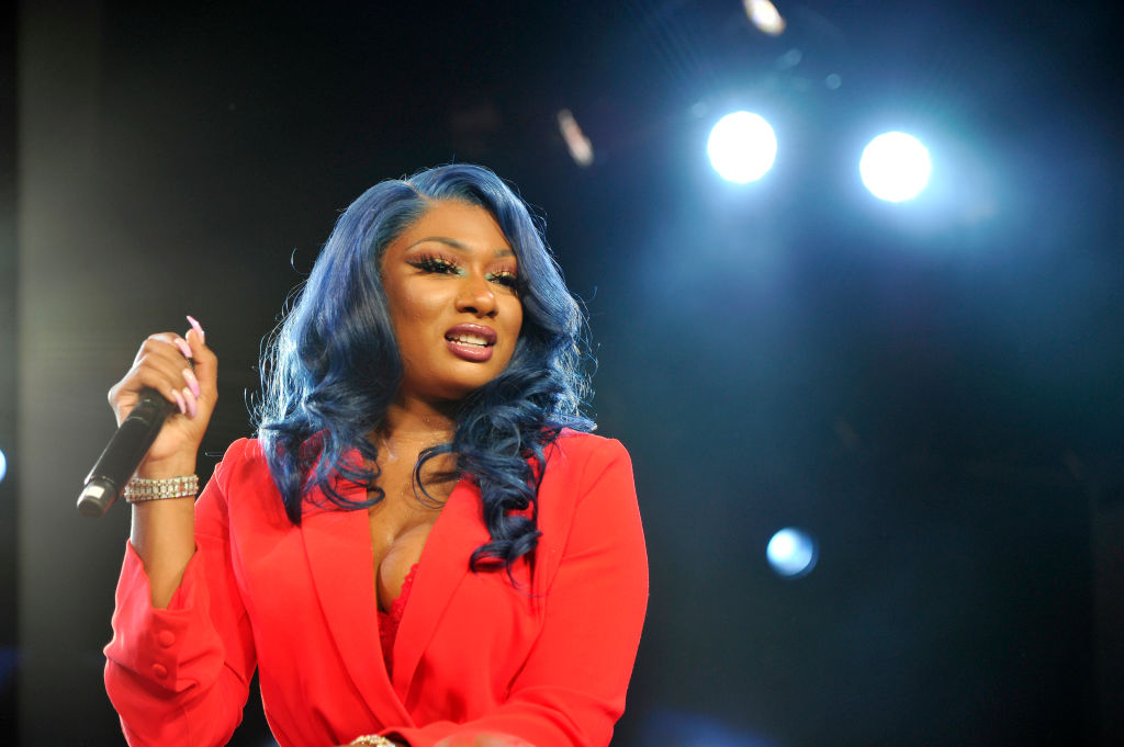 Megan Thee Stallion speaking onstage at an event in August 2019