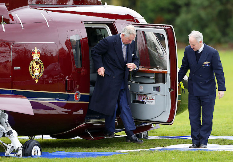 Prince Charles exits a helicopter
