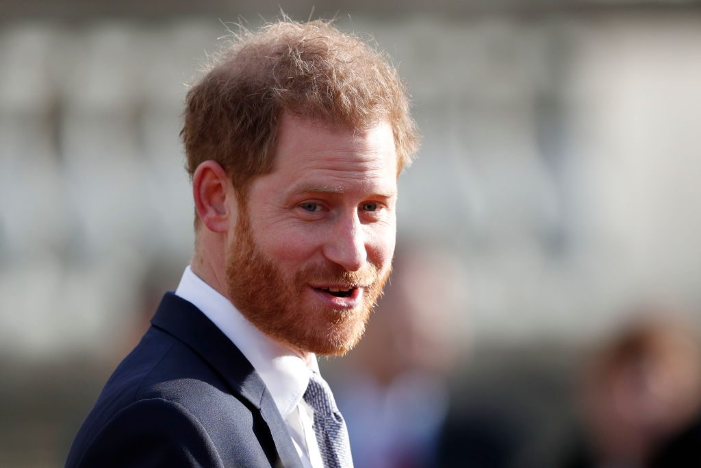 Prince Harry smiling, looking slightly off camera