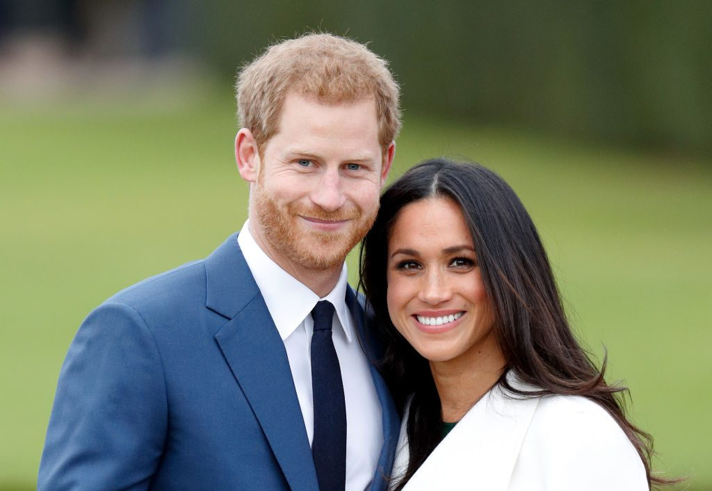 Prince Harry and Meghan Markle attend an official photo call.