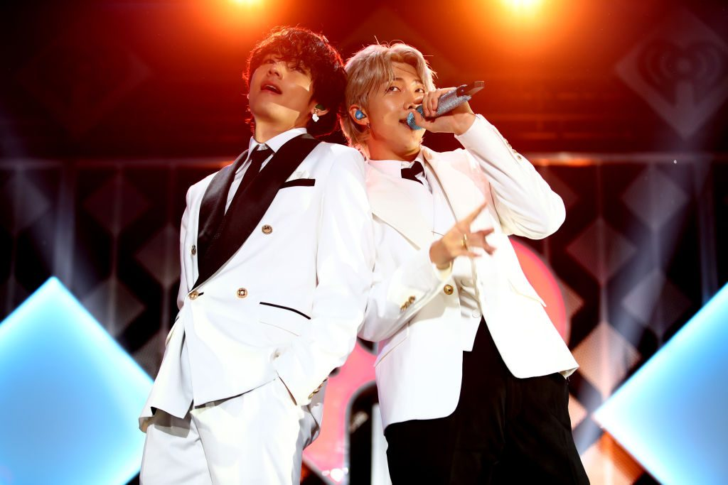 V and RM of BTS perform onstage during 102.7 KIIS FM's Jingle Ball 2019