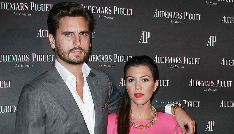 Scott Disick and Kourtney Kardashian at a party in September 2013