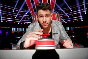 'The Voice' Executive Producer Talks About the 'Hilarious' Way Nick Jonas Judges Contestants During Blind Auditions