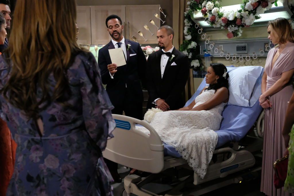 Neil Winters (Kristoff St. John) and others gather for Devon Hamilton (Bryton James) and Hilary Curtis' (Mishael Morgan) wedding on The Young and the Restless.