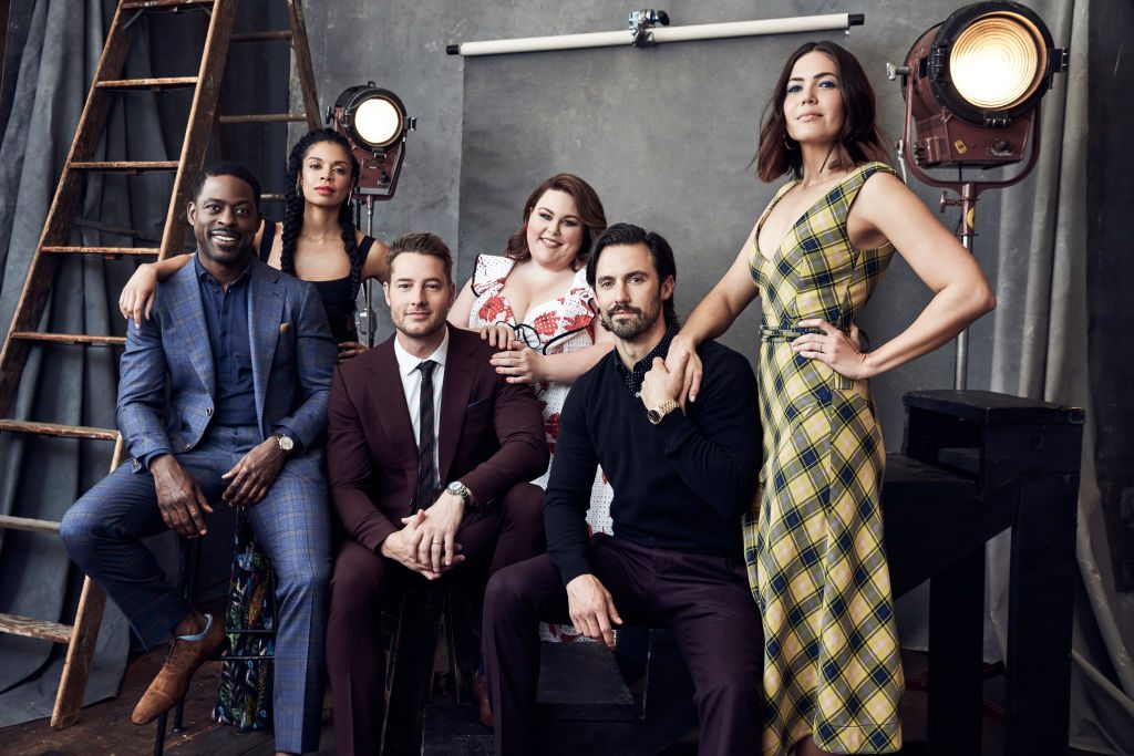 This Is Us cast in front of a textured background