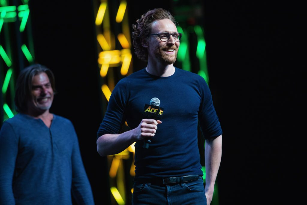 Actor Tom Hiddleston speaks on stage about life as Loki in the Marvel Universe