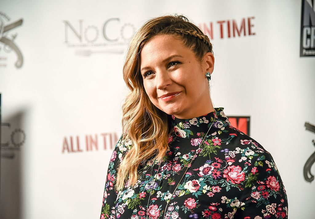 Vanessa Ray smiling in a floral top