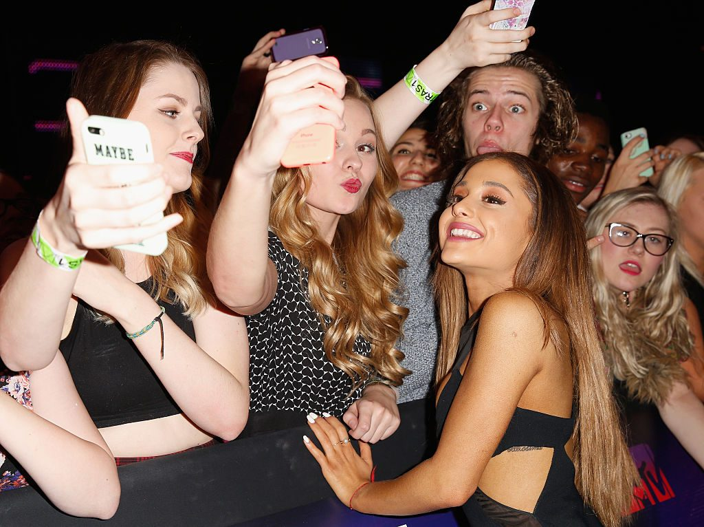 Ariana Grande poses for a selfie with fans as she attends the MTV EMA's 2014 in Glasgow, Scotland.