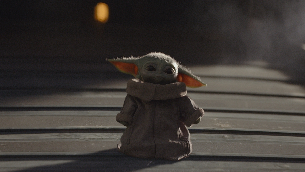 The Child (aka Baby Yoda) stands on a ship in the Disney+ series 'The Mandalorian.'