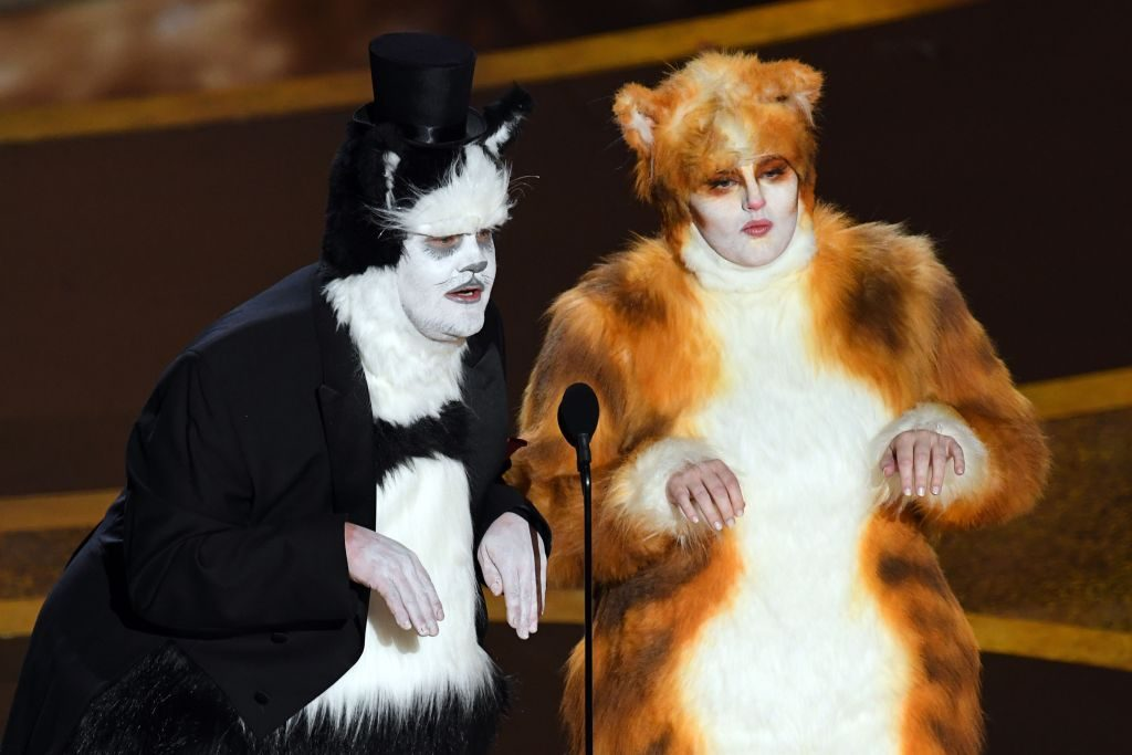 (L-R) James Corden and Rebel Wilson speak onstage during the 92nd Annual Academy Awards