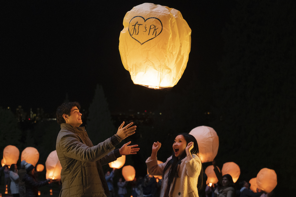 Peter Kavinsky (Noah Centineo) and Lara Jean (Lana Condor) light lanterns in 'To All The Boys: P.S. I Still Love You.'