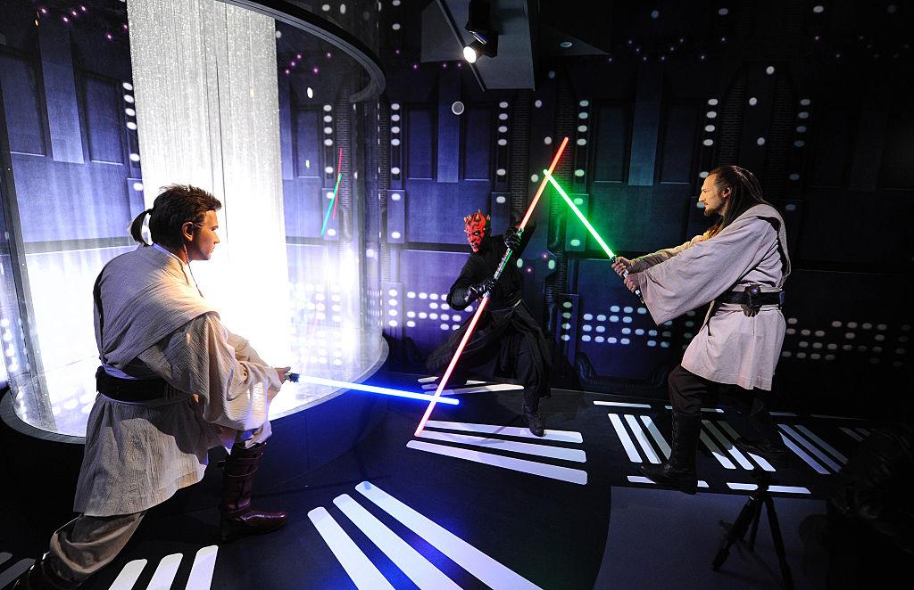 Wax figures of 'Star Wars characters' Obi-Wan Kenobi, Darth Maul, and Qui-Gon Jinn on display at 'Star Wars At Madame Tussauds' in London, England.