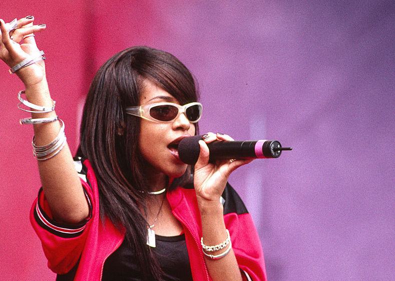 Aaliyah performing at a concert in 1997