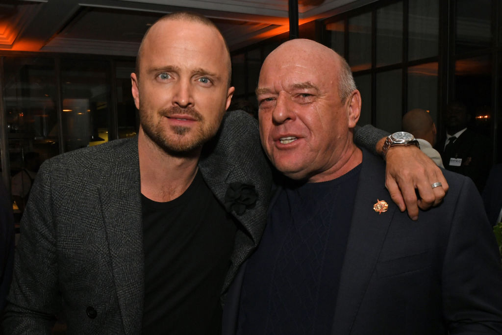 Aaron Paul and Dean Norris smiling at the camera