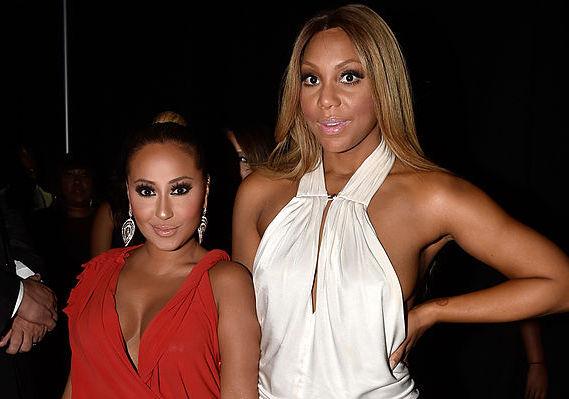 Adrienne Bailon and Tamar Braxton at an award show in June 2014