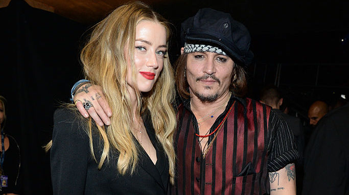 Amber Heard and Johnny Depp at an award show in 2016